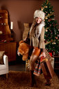 Beautiful woman arriving home from christmas shopping Royalty Free Stock Photo