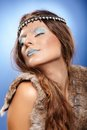 Beautiful woman as ice queen closeup of wearing fur and crown with fantasy makeup Royalty Free Stock Photography