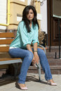 Beautiful woman attractive siting on the bench Stock Image