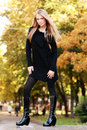 Beautiful woman in autumnal park Stock Image