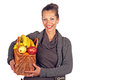Beautiful woman with a basket full of fruits and flowers on white background Stock Image