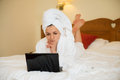 Beautiful woman in bathrobe with laptop Royalty Free Stock Photo