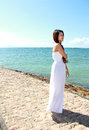 Beautiful woman at the beach alone portrait of Royalty Free Stock Image