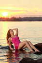 Beautiful woman on the beach at sunset enjoy nature luxury gir beauty girl relax by ocean Royalty Free Stock Photo