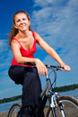 Beautiful woman with bicycle at the sea Stock Images