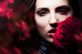 Beautiful woman with big red rose Royalty Free Stock Image