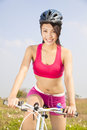 Beautiful woman biker riding folding bicycle in outdoor Stock Photo