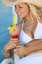 Beautiful Woman In Bikini Drinking Cocktail Stock Photos