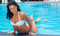 Beautiful woman in bikini poolside Royalty Free Stock Images