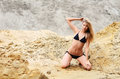 Beautiful woman in bikini on sand Stock Photography