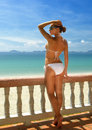 Beautiful woman in bikini on the terrace of dreams admiring sea vietnam Stock Photo