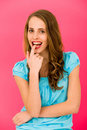 Beautiful woman biting her finger Stock Images
