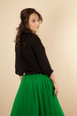 Beautiful woman with black blouse and green skirt Royalty Free Stock Photo