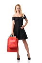 Beautiful woman in black dress with sale bags Stock Photos