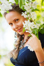 Beautiful woman among blossoming trees. Stock Photo