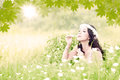 Beautiful woman blowing bubbles young attractive happy on the meadow Stock Photography