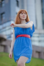 Beautiful woman in blue dress outdoors ginger haired Royalty Free Stock Photo