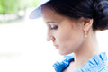 Beautiful woman in blue hat looking down Stock Photo