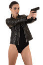 Beautiful woman in bodysuit aiming a gun Royalty Free Stock Photo
