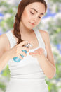 Beautiful woman with a bottle of a cream isolated on white Stock Photography