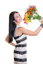 Beautiful Woman with a bouquet of colorful flowers Royalty Free Stock Image