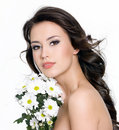 Beautiful woman with  bouquet of flowers Stock Photography