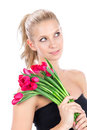 Beautiful woman with bouquet of red tulips flowers Stock Photos