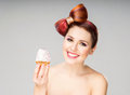 Beautiful woman with a bow haircut holding a cake Royalty Free Stock Photo