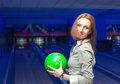 Beautiful woman in a bowling alley having fun Stock Photo