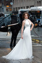 Beautiful woman bride in long white wedding dress posing in New York City street Royalty Free Stock Photo