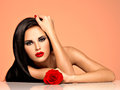 Beautiful woman with bright fashion makeup portrait of the pretty holds red rose attractive model posing at studio Royalty Free Stock Photography