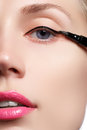 Beautiful woman with bright make up eye with sexy black liner makeup fashion arrow shape chic evening make up makeup beauty wit Stock Photo
