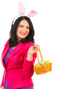 Beautiful woman with bunny ears holding basket easter egss isolated on white background Stock Photos