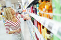Beautiful woman buying body care products Royalty Free Stock Photo