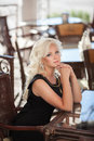 Beautiful woman in cafe restaurant, girl in bar, summer vacation. Pretty blond at breakfast. happy smiling woman Royalty Free Stock Photo
