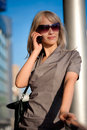 Beautiful woman calling to cellphone Royalty Free Stock Images