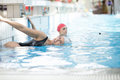 Beautiful woman cap smiling looking to camera at border of swimming pool Royalty Free Stock Photo