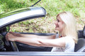Beautiful woman in the car cheerful young Stock Images