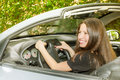 Beautiful woman in the car cheerful young Royalty Free Stock Images
