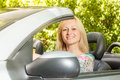 Beautiful woman in the car cheerful young Stock Image