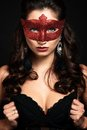 Beautiful woman with the carnival mask black background Royalty Free Stock Images