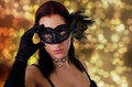 Beautiful woman in carnival mask young on a bokeh effect background Stock Images