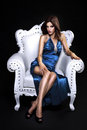 Beautiful woman in a chair sexy lady white leather armchair Stock Images