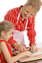 Beautiful woman and child decorating cookies Royalty Free Stock Photography