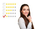 Beautiful woman choose one stars Stock Photography