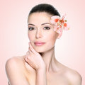 Beautiful woman with clean face and flower skin care concept Royalty Free Stock Photo
