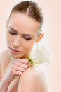 Beautiful woman close up with a flower on white background Royalty Free Stock Photography