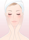 Beautiful woman closing her eyes after facial care Stock Photography