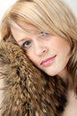 Beautiful woman in a coat fox fur collar Stock Images