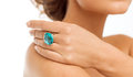 Beautiful woman with cocktail ring wedding bridal jewelry and luxury concept picture of big blue Royalty Free Stock Image